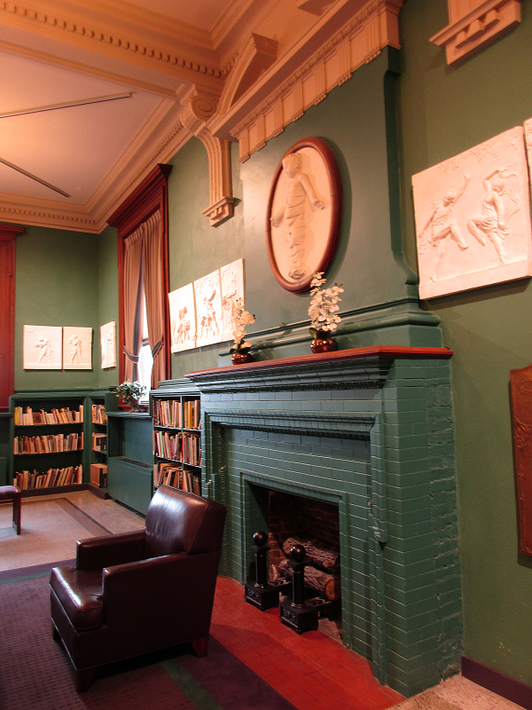 deep green fireplace in an old library